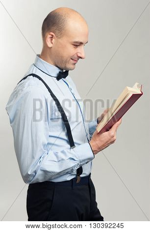 Stylish Bald Man Reading A Book