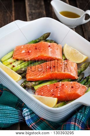 Raw fresh delicious salmon green asparagus and lemon in pan ready to cook