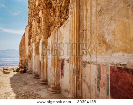 Masada fortress in Israel, fragments of columns embedded into the wall and wall paintings in King Herod's palace