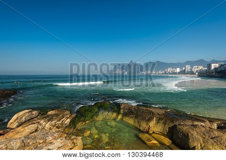 Rocks of Arpoador Beach and Ipanema Beach view in Rio de Janeiro, Brazil.