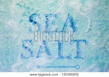 The inscription Sea Salt covered with close up salt crystals