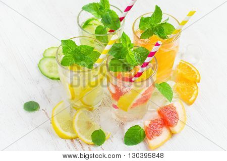 Summer drinks with ice mint and citrus. Infused water in glass.