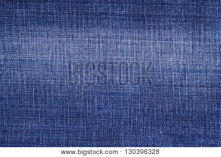 Texture of blue jeans background blue  worn