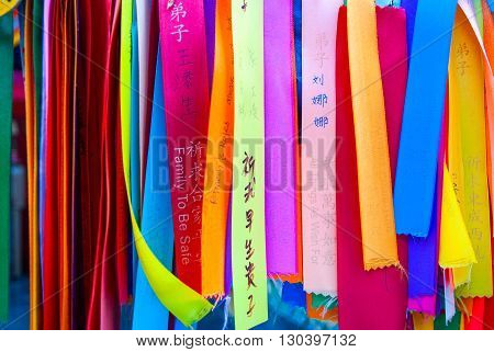 Wish ribbons in chinese buddhist temple Malaysia