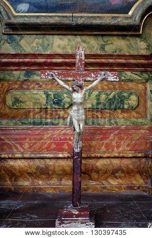 KOTARI, CROATIA - SEPTEMBER 16: Cross on the altar in the church of Saint Leonard of Noblac in Kotari, Croatia on September 16, 2015.