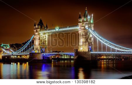 Tower Bridge in London on the Thames river shot at night with Long Exposure