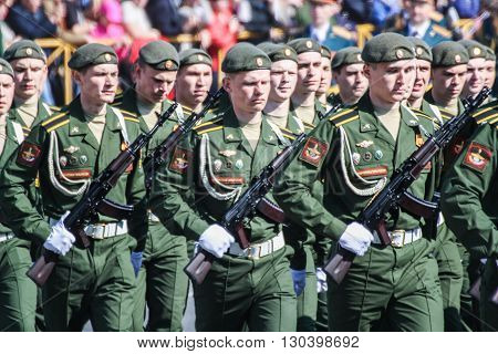 St. Petersburg, Russia - 9 May, Soldiers with Kalashnikovs in the parade, 9 May, 2016. Festive military parade on the Palace Square in St. Petersburg.
