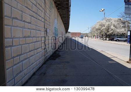 JOLIET, ILLINOIS / UNITED STATES - APRIL 26, 2015: The sidewalk and wall outside the Joliet Union Station in downtown Joliet.