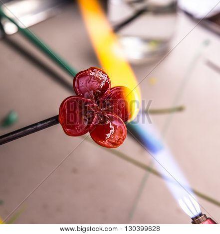 Lampwork  gas burner glows glass decoration flower.