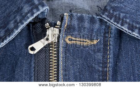 Detail of a light blue denim jacket