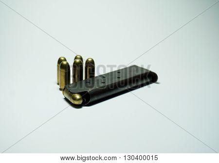 11 mm pistol ammunition isolated on white background.