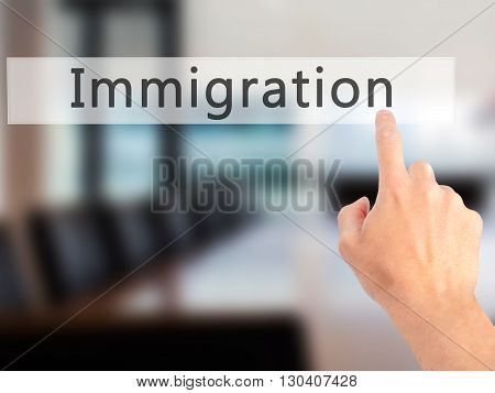 Immigration - Hand Pressing A Button On Blurred Background Concept On Visual Screen.