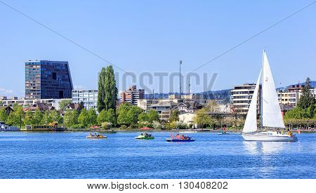 Zugб Switzerland - 6 Mayб 2016: view on the city of Zug from Lake Zug. The city of Zug is the capital of the Swiss canton of Zug. Lake Zug (German: Zugersee) is a lake in central Switzerland situated between Lake Lucerne and Lake Zurich.