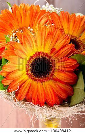 Bouquet Of Three Orange Gerberas In Bottle