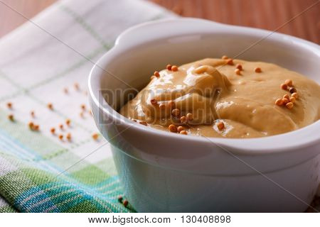 Orange Mustard With Seeds In White Bowl