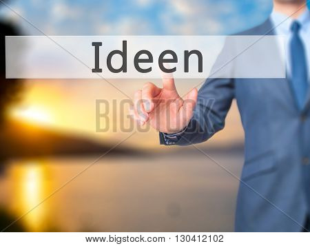 Ideen (ideas In German) - Businessman Hand Pressing Button On Touch Screen Interface.