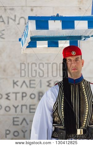 Athens Greece - April 30 2016: Soldier guards the Tomb of the Unknown Soldier at Syntagma Square Athens Greece