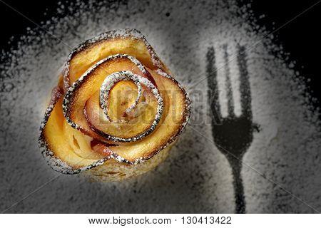 apple shaped rose dessert with fork imprint