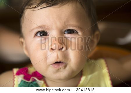 Baby Girl Looking At Camera With Funny Face