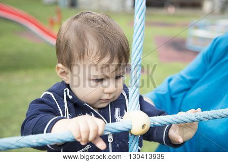 Baby Looking At Blue Ropes