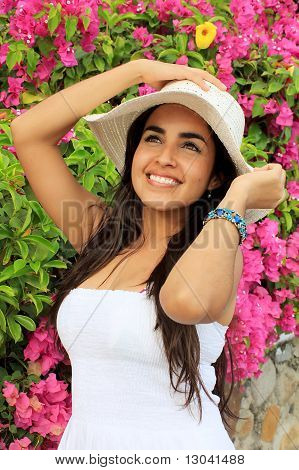 Beautiful Woman In Front Of Bougainvilleas