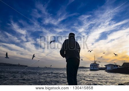 Istanbul Turkey- February 2 2014: Sea of Marmara the Bosphorus in the evening. sunset seagulls and people