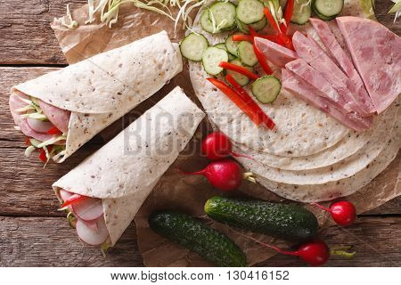 Sandwich Rolls With Ham, Cheese And Fresh Vegetables Close-up. Horizontal Top View