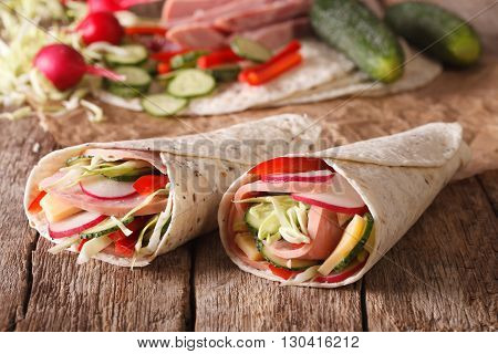 Sandwich Roll Stuffed With Ham And Vegetables Close-up. Horizontal