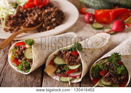 Tortilla Rolls With Minced Meat, Vegetables And Ingredients Close-up. Horizontal