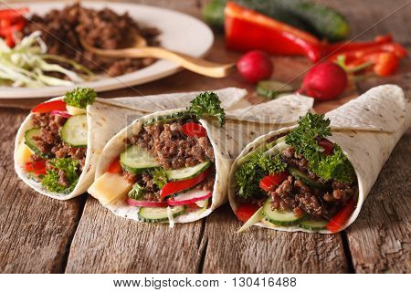 Tortilla Roll With Beef And Vegetables Close-up And Ingredients. Horizontal