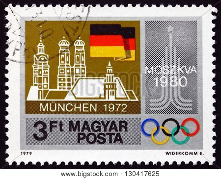 HUNGARY - CIRCA 1979: a stamp printed in Hungary shows Moscow '80 Emblem and Our Lady's Church Munich and German Flag circa 1979