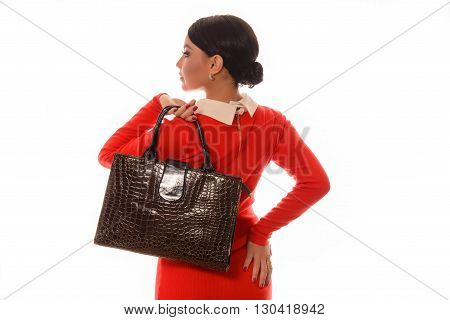 woman in a red dress with a brown bag standing on white background back
