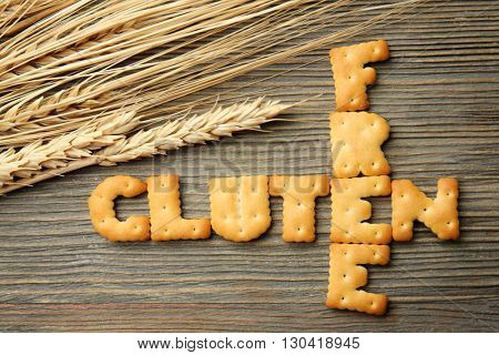 Gluten Free concept with wheat spikelets on wooden background