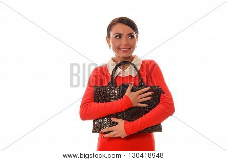 woman in a red dress with a brown bag standing on white background