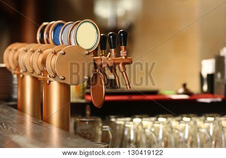 Draught beer taps in a bar.