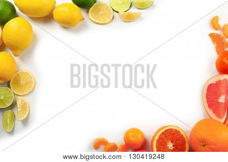 Fresh mixed citrus fruit including   lemons, limes, grapefruits, oranges and  tangerines isolated on white background, top view