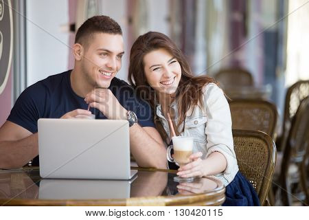 Couple With Laptop At A Cafe