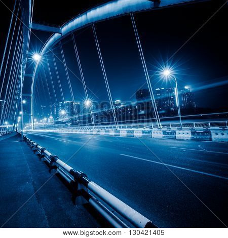 traffic trails on bridge,chongqing china,blue toned image.