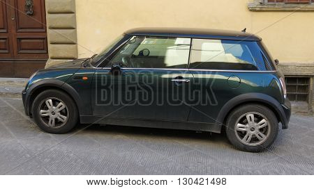 AREZZO ITALY - CIRCA APRIL 2016: dark green Mini Cooper car with black roof