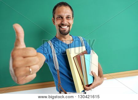 Learn it's cool! Joyful teacher showing thumbs up. Photo adult teacher near blackboard education concept