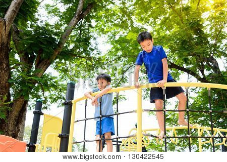 Boy Climb On The Rope Fence