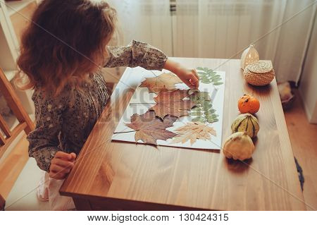 preparations for autumn craft with kids. Herbarium from dried leaves. Learning children at home fall nature collage.