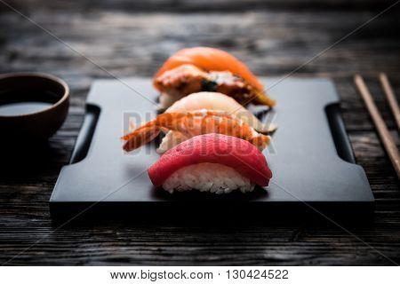 sashimi sushi set with  soy on black background