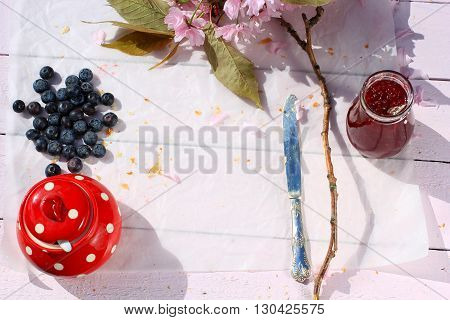 Rustic wooden breakfast ackground with bluberries and copy space