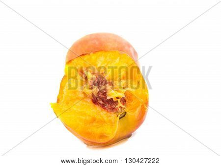 bitten juicy peach on a white background