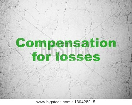 Currency concept: Green Compensation For losses on textured concrete wall background