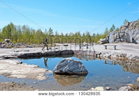 RUSKEALA, KARELIA, RUSSIA - MAY 14, 2016: Tourist near Italian Quarry and Marble Lake in The Mountain Park