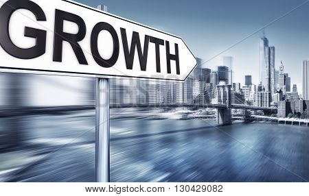 picture of a growth sign in front of the manhattan skyline