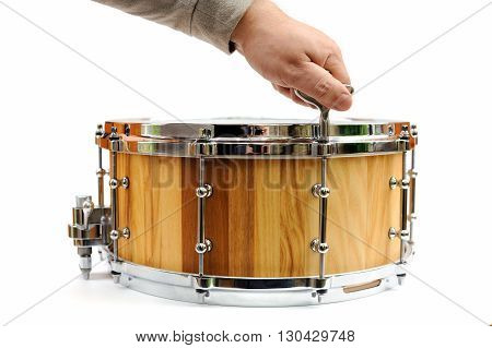 Master tuning new wooden snare drum isolated horizontal