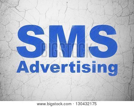 Marketing concept: Blue SMS Advertising on textured concrete wall background